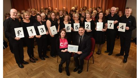 Members of Discord, the wellbeing choir making a presentation to Cancer Research UK in January 2020.
