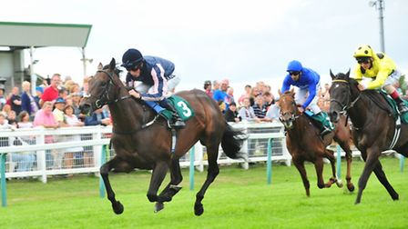 Johnny Barnes ridden by William Buick wins the 5.05 at Yarmouth.