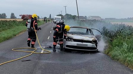 Not an uncommon sight but all in a day's work as fire fighters tackle a car that is on fire.