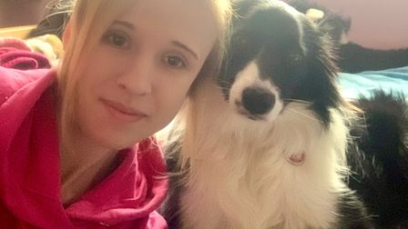 Amy Brown, 25, with her dog Zola, has returned home after being hospitalised for Covid.