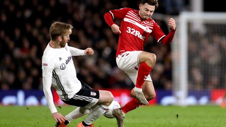 Fulham's Tim Ream (left) and Middlesbrough's Patrick Roberts battle for the ball during the Sky Bet