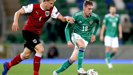 Austria's Martin Hinteregger (left) and Northern Ireland's Gavin Whyte battle for the ball during th