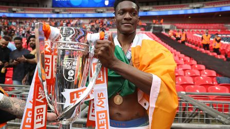 Blackpool's Armand Gnanduillet celebrates with the trophy after the Sky Bet League Two play-off fina