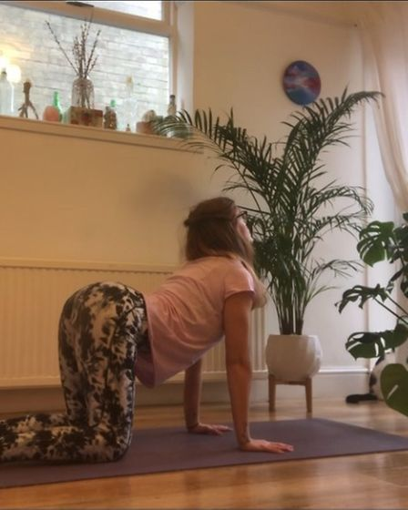 Lexi Spall, a yoga teacher from Gorleston, showingthe 'cow position' from 'cat-cow'.
