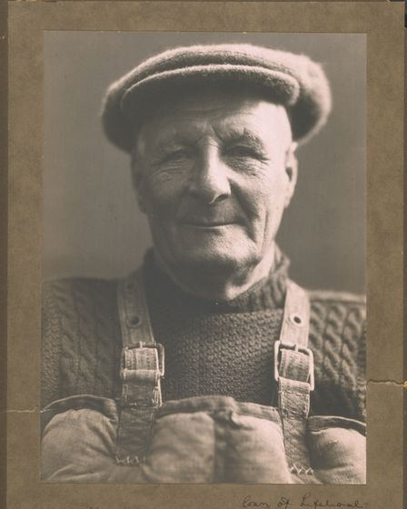 Henry Blogg, coxswain of Cromer lifeboat in jersey, cap and Kapok lifejacket - 1942.