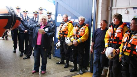 The Rev Catherine Dobson blesses Sea Palling lifeboat with coxswain Paul Dale (right), crew and coa