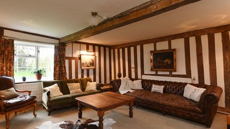 Period style reception room featuring exposed beams and wooden studwork on the wall