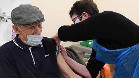 John Game receives his Covid -19 vaccination by pharmacy technician for One Norwich, Marion Ridge, a