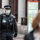 A policeman wearing a mask in Ipswich town centre during the coronavirus pandemic