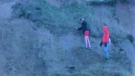 Two people were see climbing a cliff between Walcott Ostend and Happisburgh.