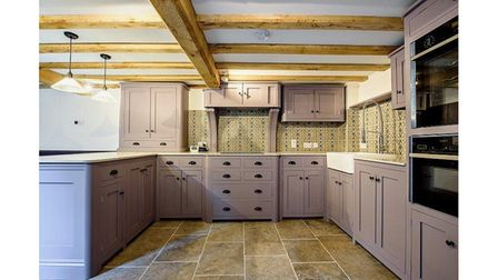 The property features a large kitchen which looks out over a walled courtyard.