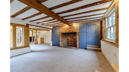 Wooden beams, exposed brick walls and fireplaces are featured throughout the house.