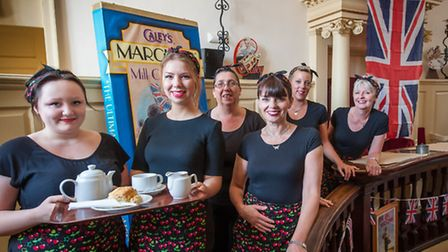 Waitresses dressed for the wartime theme at Caley's café in Norwich. Photo: Bill Smith