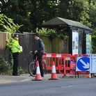 Police carry out checks one week after a serious crime at a bus stop on London Road South.