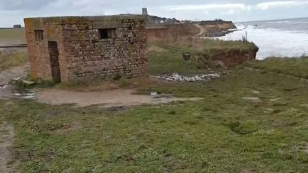 The cliffs in front of a pillbox at Happisburgh are crumbling.