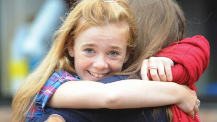 Students celebrate their GCSE results at Hethersett High School. Picture: Denise Bradley