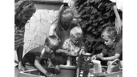 Children playing with sand at a playschool in Hadleigh in September 1990