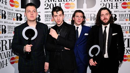 (L-R) Matt Helders, Alex Turner Jamie Cook and Nick O'Malley from Arctic Monkeys with their awards i