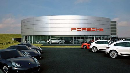 outside Porsche centre with cars