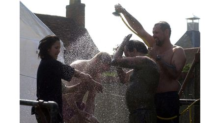 Mud race contestants wash off after the race at Manningtree Regatta in 2002