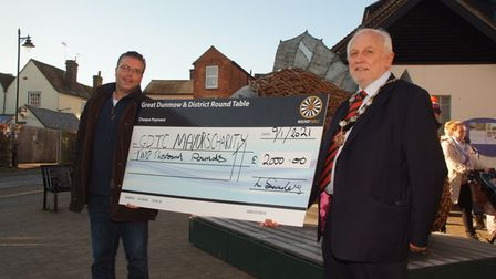 Two men with giant cheque