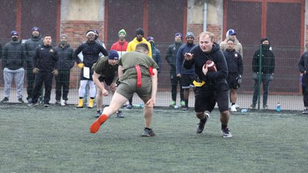 British and American troops competed in a U.S. Thanksgiving tradition of American Football