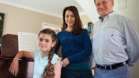 Alexandra Wetherall with her parents at home in Surlingham. Photo: Bill Smith