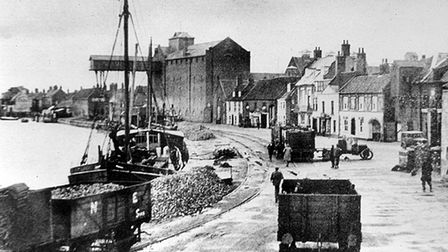 A black and white picture of a busy Wells-next-the-Sea