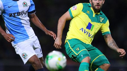Lee Williamson of Blackburn Rovers and Bradley Johnson of Norwich in action during the Sky Bet Champ