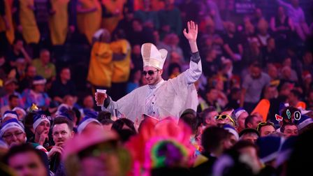 Darts fans enjoy the atmosphere during day eight of the William Hill World Darts Championship at Ale