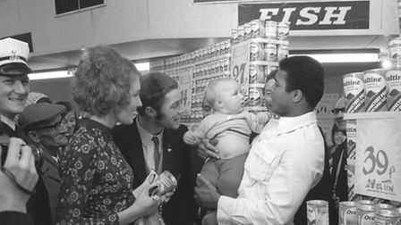 Muhammed Ali, the greatest boxer in the world, meets the public in the supermarket T. W. Downs in St