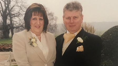 Helen, pictured with her husband Robert, helped 'countless' people in her role at the Stowmarket Jobcentre