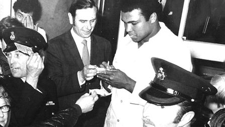 The late DC Alan Brown getting Ali's autograph.