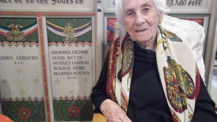 Ruby Ford sitting in front of the Think and Thank Screen in St Andrew's church in Great Ryburgh, by