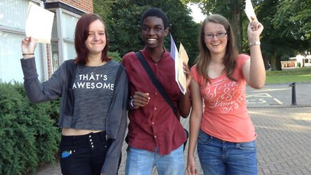 Happy with their results at Gresham's. Catherine Chamberlain, Phillippe Cato and Clare Mawson. Pictu