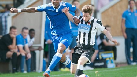 Jefferson Louis of Lowestoft Town tussles for possession with Adam Dodd of Chorley during the Confer