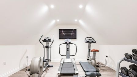 Gym equipment in a brightly lit eaves space