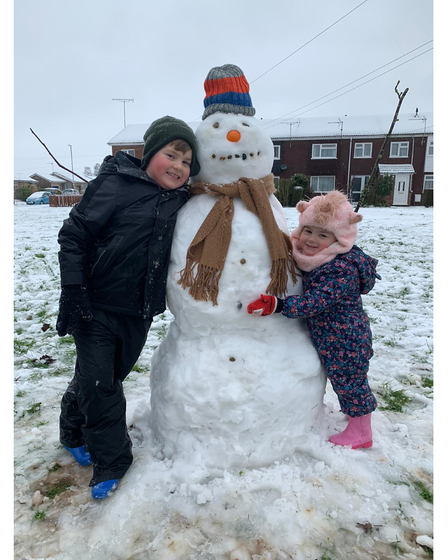 Youngsters building a snowman in Kesgrave