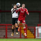 Newport County's Brandon Cooper (left) and Crawley Town's Max Watters battle for the ball during the