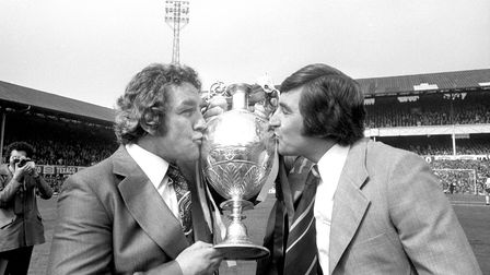 Dave Mackay (left), manager of Derby County, and his assistant Des Anderson, kiss the League Trophy