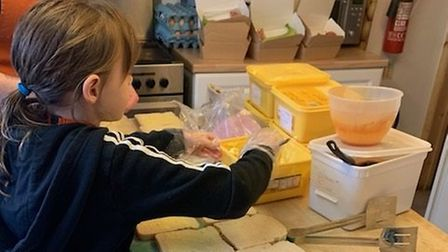 Chris Fletcher's daughter Holly, aged,7, helping making lunches for children