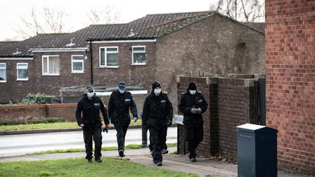 Police investigate the scene after a woman in her 20s died in Colchester.