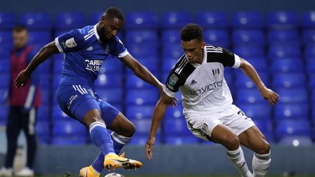 Ipswich Town's Janoi Donacien (left) and Fulham's Antonee Robinson battle for the ball during the Ca