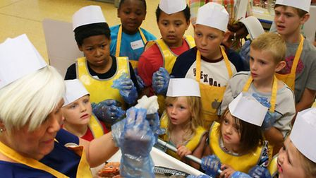 Children learning about where their food comes from on a visit to Blue Boar Lane Tesco, organised by