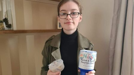 Bethany-Kate McKenzie, 14, from Costessey, with her homemade badges for the Norfolk and Norwich Hospitals Charity.
