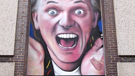 David Nash (Gnasher) created a 20ft (6m) high mural of Rik Mayall in Essex. Picture: SUPPLIED