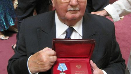 Raymond Banger picking up his medal: Submitted