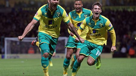 Norwich City midfielder Bradley Johnson leads the celebrations after his goal in the 3-1 win over Bl