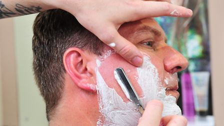 Ollie Tibble has just launched a new men's grooming parlour, where he offers traditional cut throat