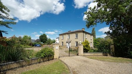 Large Georgian property set back from the road with a large sweeping driveway in the front